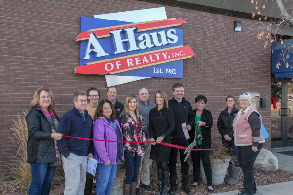 A Haus of Realty, Inc. had a ribbon cutting ceremony outside of their new location in Laurel on Monday. They will be hosting an open house on Friday from 9 a.m. to 5 p.m. and will offer coffee, cookies and prizes throughout the day. From the left are Renee Studiner, Bruce Larson, Peggy Olsen, Sandy Reese, Brent Renier, Camilla Nelson, Ryan Mayes, Angela Klein-Hughes, Daniel Klein, Hazel Klein, Katie Whitmoyer and Marcia Hafner.