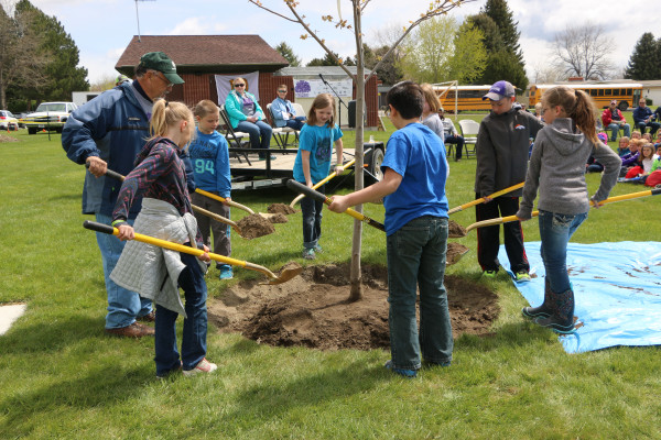 A select group of fourth-grade students and Laurel Mayor Mark Mace planted the final tree for the Tuesday, May 2, Arbor Day celebration in Murray Park. Sitting in the background are Laurel Chief Administrative Officer Heidi Jensen and Laurel School Supt. Linda Filpula.
