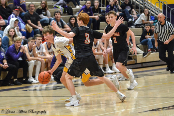 Photo courtesy Gloria Allwin. Laurel's Levi Taylor drives by a Billings Senior defender during Saturday's home game. The Locos defeated Columbus 62-32 on Friday and fell to the Broncs on Saturday, 63-46.