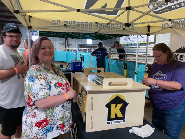 Tony and Jenna Nardella line up for beer at the Kettlehouse Brewing Company booth.