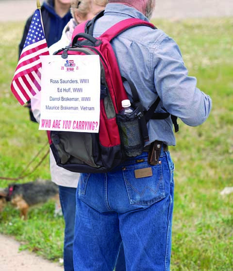 Ed Saunders dedicated his march to he and his wife Charlene's late fathers, who were WWII combat veterans, as well as other family members who served.