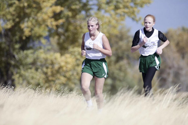 Photo courtesy Livingston Enterprise.  CJ Roadrunner athletes Megan Deines, left, and Jalyn Songstad are seen at the recent Big Timber cross country meet.