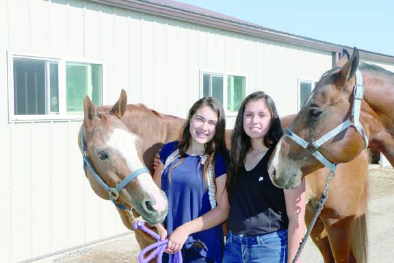 Rachel Spint, right, and Ciara Berkman pose with the horses they have been working with since October for this year's MontanaFair 4-H competitions             . More 4-H photos on page 9.