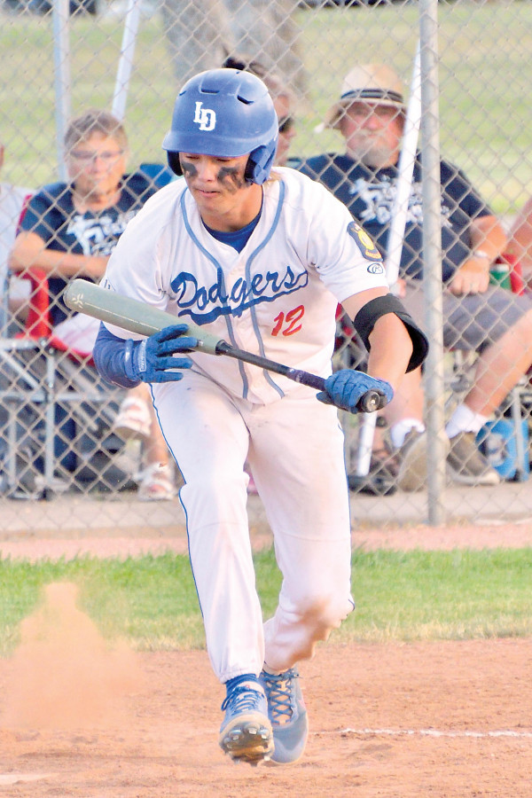 Jaxon Wittmayer backs off a bunt attempt during a game against Lewistown on July 1st. The Dodgers picked up wins against the Redbirds and Billings Cardinals last week to extend their winning streak to nine games.