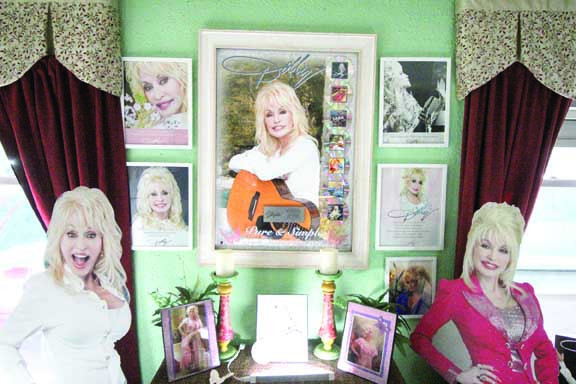 "Wes Salveson's Laurel home is completely filled with all things Dolly Parton. In the center of the photo is a promotional poster and plaque from Parton's 2016 ""Pure and Simple"" tour which she presented to Salveson when he met her at the concert in Deadwood, S.D."
