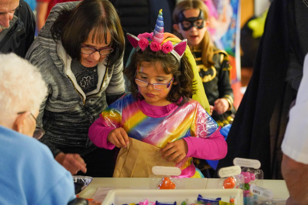 This young unicorn picks out some prizes and treats at the Laurel Chamber of Commerce Halloween party at the Middle School on Thursday evening.