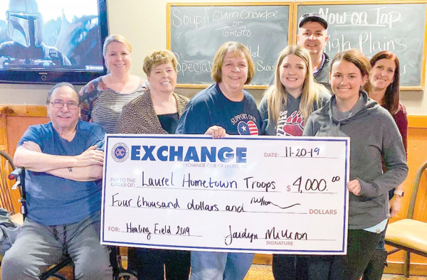 Club members were happy to award $4,000 to the Laurel Hometown Troops at their recent meeting. Shown from the left are Ken Gomer, Misty Wittman, Opal Gomer, Ranae Marshall (Hometown Troops), Jaidyn Milliron, Justin Whitfield, Cassie Bickler and Krista Whitfield.