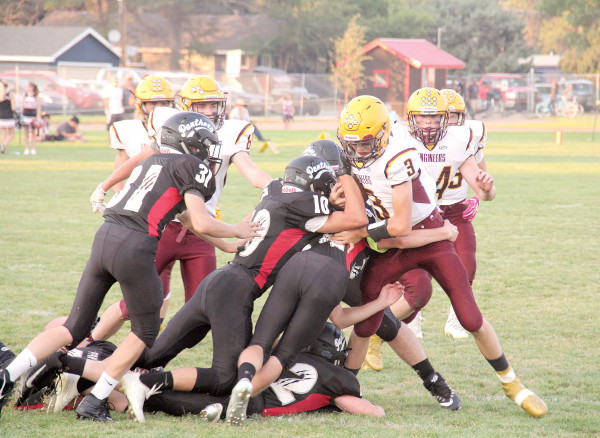 A gang of Panther defenders attempt to strip the ball from Harlowton's quarterback. The defense held the Engineers scoreless in the second half, and came up huge on a clutch red zone stop with 0:36 left in the game.