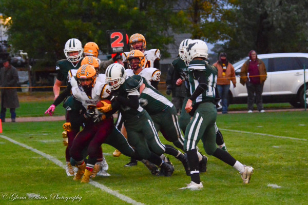 Photo courtesy Gloria Allwin photography. A gang of J-Hawk defenders stuffs a Harlowton running back during a 50-12 rout of the Engineers. Joliet improved to 4-0 on the season and are tied for first in the conference.