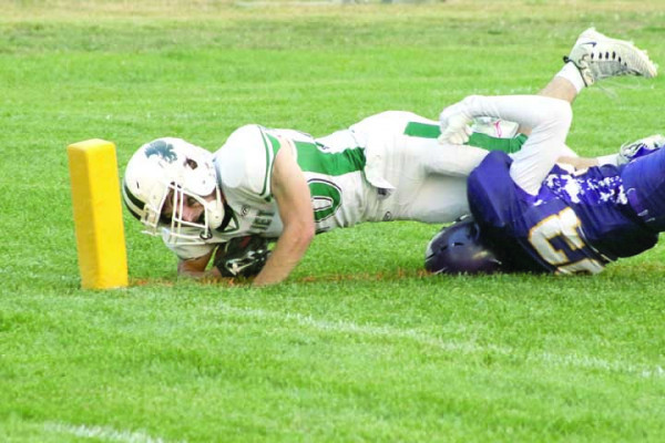 Photo courtesy Lynn Kramer. Joliet J-Hawk senior running back Trey Oswald stretches for the two point conversion in the season opener Friday night at Broadview/Lavina. The J-Hawks took down the Pirates 46-8 in their first game in the new 8-man division.