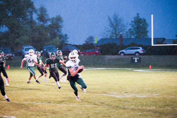Photo courtesy Lewistown News Argus. Joliet wide receiver Rylan Olson sprints for the sideline in a downpour Saturday in Hobson. The J-Hawks came back from a 24-point third quarter deficit to beat the top ranked Tri-City Titans 42-36.