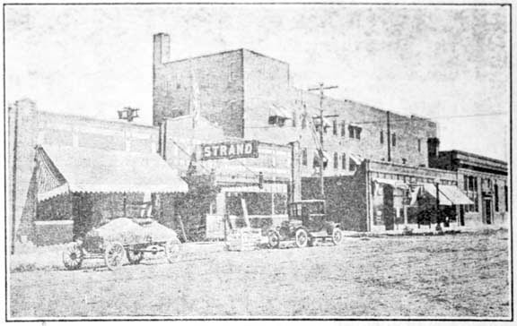 The east side of First Ave. in 1920 boasted the Strand Theatre in the location where Town Square now sits. Check out the convertible on the left side of the photo.