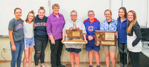 Outlook photo by Chris McConnell  The 2018 State Championship golf team is seen with the 1971 State Championship team at Laurel High School on Tuesday. The 1971 team offered congratulations to this year's team on the historic victory 47 years after they brought the first state title to LHS. From left: Haylee Adams, Hannah Adams, Keli Hodges, Dee Peterson Baxter, Judy Burke, Janny Burke, Madi Cooney, Lexie Harper, and Elise Shovar.  Outlook photo by Chris McConnell  The 2018 State Championship golf team is s