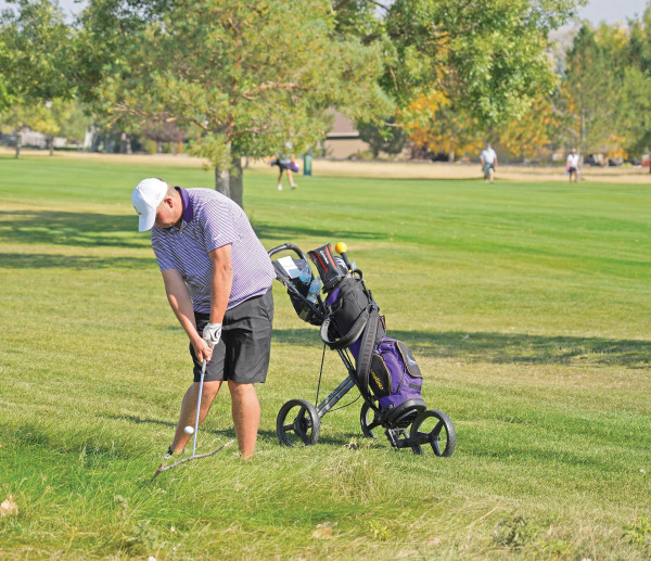 LHS Senior Landen Gradwohl hits a recovery shot from the fescue at Lake Hills Golf Course last Thursday during the Eastern A Divisional golf tournament. Gradwohl shot 82 to finish 6th in his Divisional tournament debut. Outlook photo by Chris McConnell