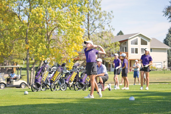 2020 Eastern A Divisional Champion Hannah Adams hits a tee shot on the 4th hole at Lake Hills Golf Course while her coach and teammates watch. Adams shot 79 to take medalist honors and lead the Lady Locos to their third consecutive Divisional title. Outlook photo by Chris McConnell