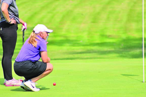 LHS Junior Molly Cooney lines up a putt during her round in Miles City last week. She fired a career best 81 to take 2nd place in the tournament individually behind teammate Breana Jensen.