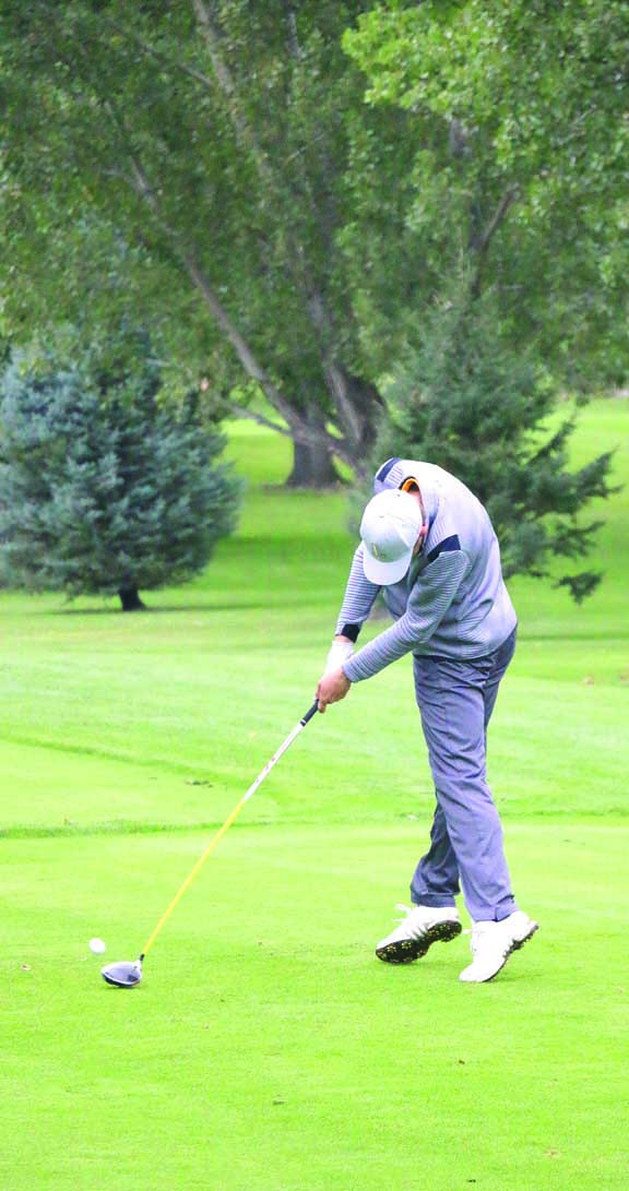 Outlook photos by Chris McConnell                        Laurel Junior Carson Hackmann gets airborne on the 10th tee during the Laurel Invitational last Friday. Hackmann fired an even–par 72 to claim medalist honors. The Laurel boys finished 2nd as a team behind the Bozeman Hawks.