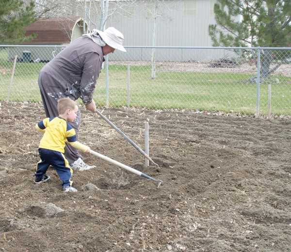 Courtesy photo                        The author of 'Gardening at 46 degrees,' Larry Field passing on his knowledge to grandson Haiden.