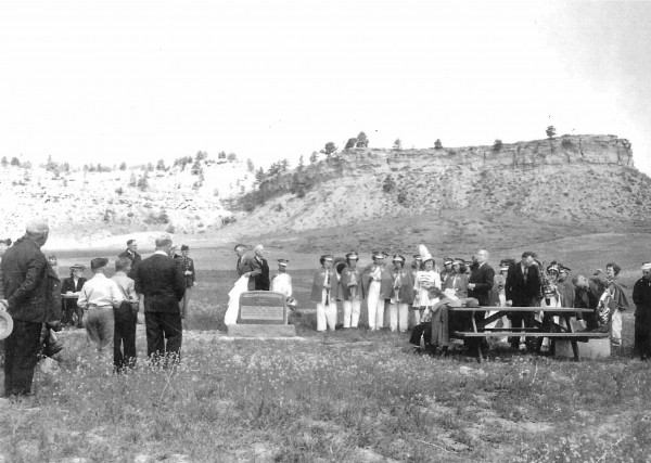 The original grave of Joseph Tate and Chauncey Ames, the two men killed by horse thieves, near Square Butte when it was dedicated in the 1950s. The photo is used courtesy of Burt Mitchell, who said his sister was in the band and his grandfather is also in the picture.