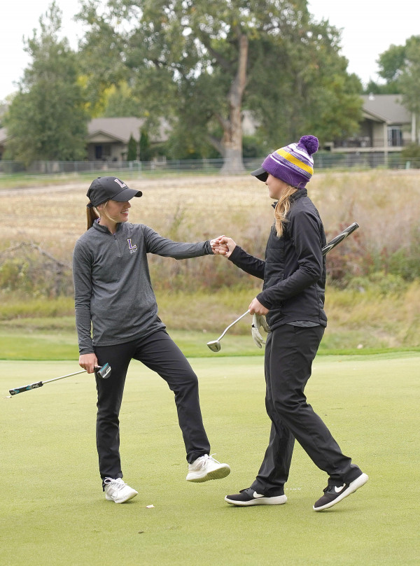 Photos by Chris McConnell                        Hannah Adams (left) fist bumps her sister Haylee on their 18th hole on Friday after she won the Class A State Individual title. The Laurel girls also won their second consecutive State Title by a wide margin.