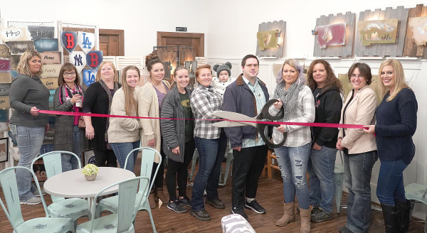 Outlook photo by Chris McConnell                        Harmony held a re–opening ceremony on Tuesday with the new owner. From the left are Megan Cutting, Dawn Musson, Amanda Powell Joy Hunt, Ginger Wipf, Judith Wipf, Jennifer Wetzel (holding Amayah), Evan Bruce, owner Tera Wombolt, Patsy Woody, Carrie Smith and Cami Nelson.