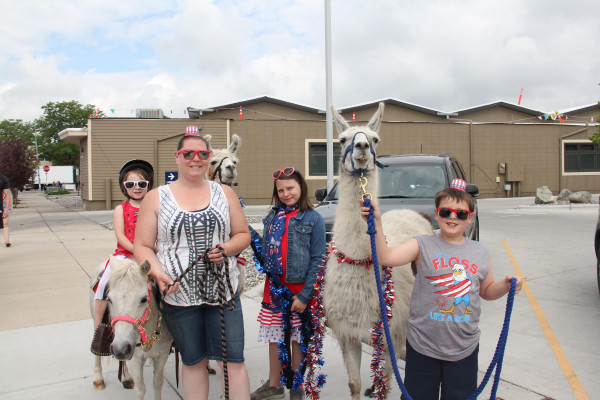 Outlook photo by Chris McConnell                        Llamas, ponies and kids are ready for the start of the Kiddie Parade. The Cardwell clan had kids, llamas and ponies. Pictured from left are Addy riding Sugar, Leslie, Kaiya with Hazel, and Brayden Cardwell with Target.