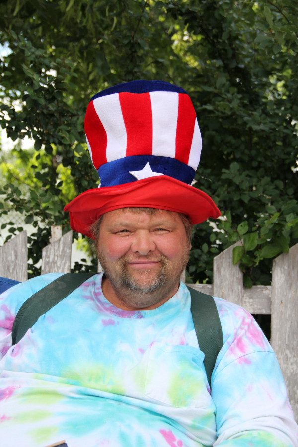 Outlook photo by Chris McConnell                        Roger Osborne is decked out for the day in tie dye, topped with a patriotic hat.