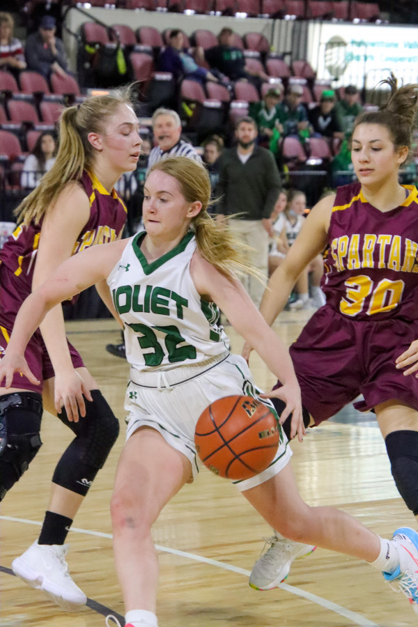 Joliet's Merrin Schwend drives the lane against Baker during a 59-39 play in game win at the Souther B Divisional Tournament. The Lady J–Hawks picked up three wins in the tournament to take 4th place. Photo courtesy Michelle Carpenter