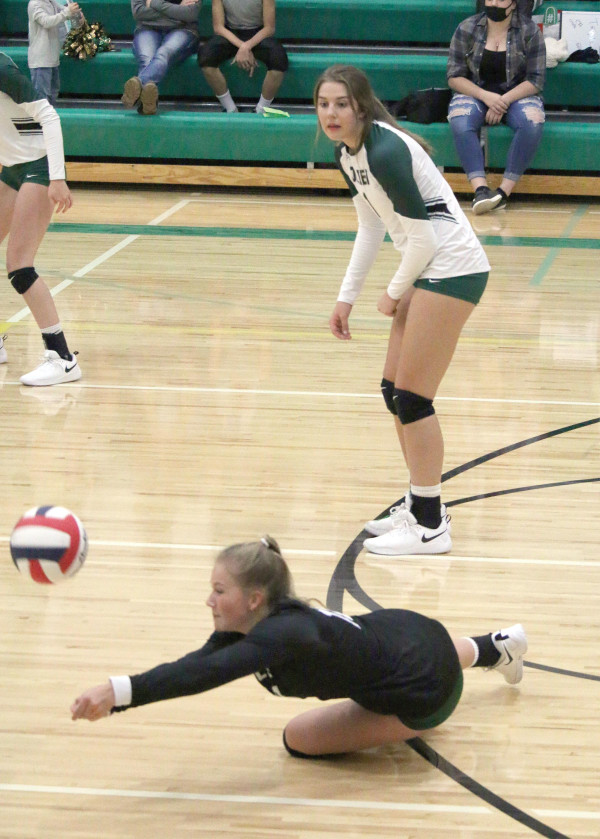 Kylia Liner goes for the dig while Makenna Bushman watches at a recent Joliet match against Red Lodge. Photo courtesy Michelle Carpenter