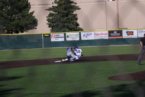 Laurel infielder, Keagan Campbell, tags out an opponent attempting to slide into second base.