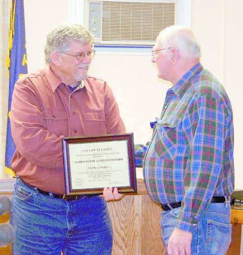 Former Mayor Ken Olson congratulates former Mayor Chuck Rodgers on his retirement from city government in January 2012.