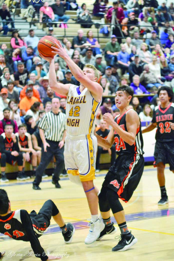Photo by Gloria Allwin. Logan Kennedy of Laurel takes the shot in a game against Hardin last week. Laurel's next game is home against Miles City on Jan. 6.