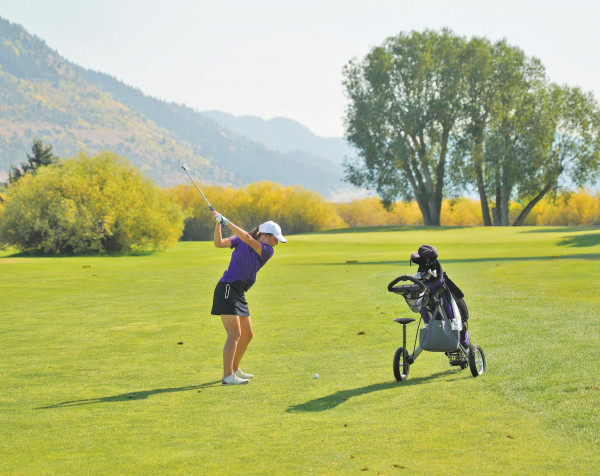 Laurel freshamn Alivia Webinger hits an approach to the 16th hole at Butte Country Club during the final round of the State Class A Championship. She hit nine 9–iron from 122 yards to three feet and made the birdie putt en route to finishing in second place individually. The Lady Loco golf team won their 3rd consecutive State title in record–breaking fashion. Outlook photo by Chris McConnell