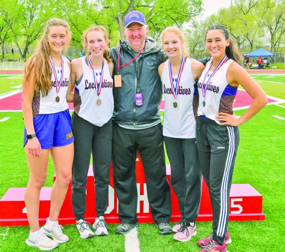 Kayla Parsons (6th), Lauren Taylor (5th), Coach Haskins, Grace Timm (1st) and Andria Mourich (2nd) after the 800m race at the Class A Divisional Meet in Glendive last weekend.