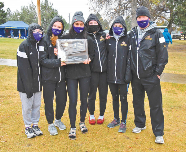 The Lady Loco cross country team is seen with their first place Divisional trophy last week in Lewistown. From the left are Ruby Smith, Grace Timm, Andria Mourich, Lauren Taylor, Carly Cook and Head Coach James Haskins. Photo courtesy Gloria Allwin