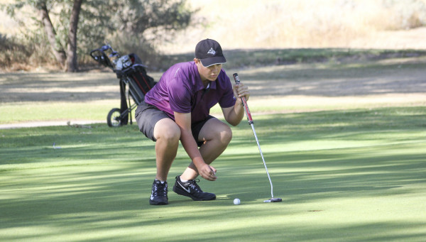Photo courtesy Kyle Vuille, Yellowstone Newspapers. Ryan Kallem lines up a putt at the Glendive Invitational on Friday. Kallem took 4th on the team after firing an 89. Paul O'Neil was medalist and the Laurel boys golf team won the event, beating conference rival Billings Central by six shots.