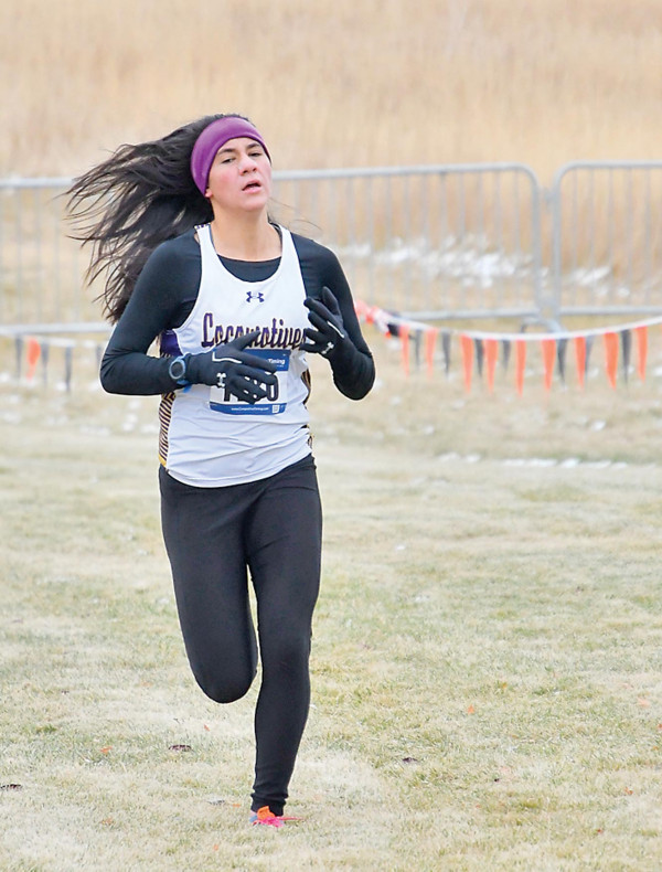 Laurel senior Andria Mourich approaches the finish during the Class A State Cross Country meet on Saturday. Mourich finished runner–up and the Lady Locos won only the 2nd State title in school history.