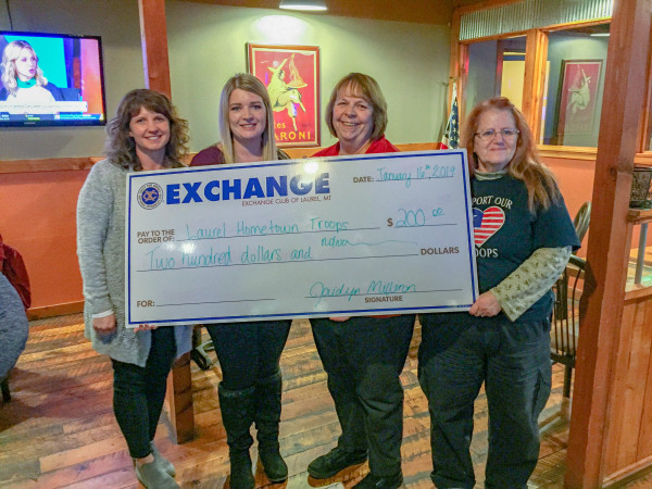 Hometown Troops Jennifer Sletten and Jaidyn Milliron presents a check of $200 to the Hometown Troops members, Renee Marshal and other group member.