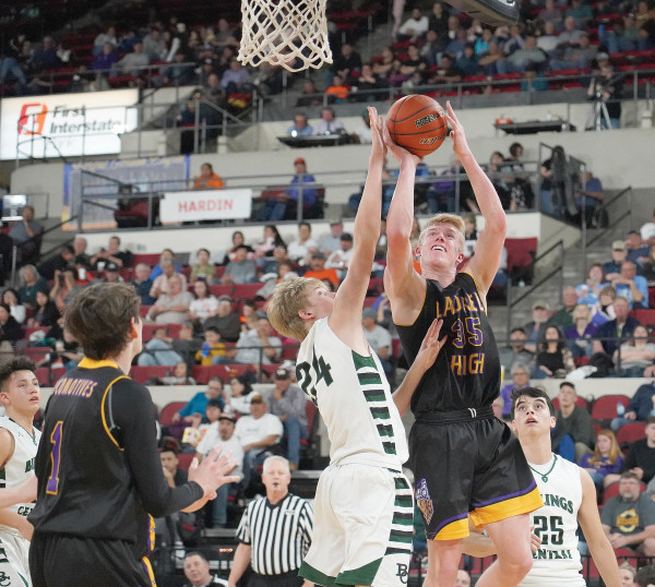 Loco junior Colter Bales goes up for two in traffic at during Laurel's divisional semi–final matchup against Billings Central. Outlook photo by Chris McConnell