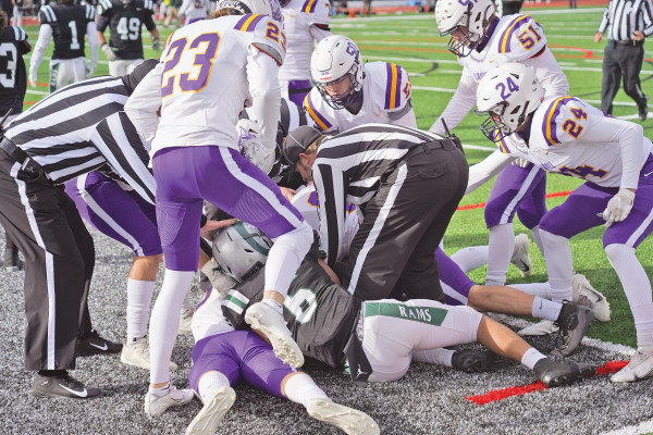 The officials break up a scuffle between Laurel and Billings Central players after a Loco touchdown during their 34–0 State Championship victory in Lockwood on Nov. 14.