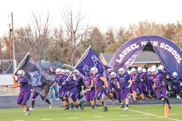The Locomotive football team exits the tunnel before the start of their quarter–final playoff game against Frenchtown on Friday. Laurel won the game 35–13 to advance to the semi–finals against Hamilton this Saturday. Photos courtesy Kathleen Linger