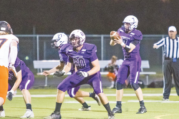 Eli Aby looks for a receiver during Laurel's home win over Frenchtown two weeks ago while James Ochs (27) and Landen Baxter prepare to block. The Locos beat #1 ranked Hamilton on Saturday to advance to their second consecutive State Championship game against Central this Saturday at 1 p.m. in Lockwood.