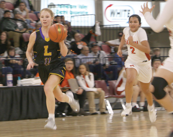 Grace Timm takes the ball down the court on a fast break during the game against Hardin on Friday, Feb. 28 at the First Interstate Auto Arena. Outlook photo by Jackson McMurrey