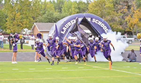 The Locos run out of the tunnel before the start of the Billings Central game on Sept. 25. They fell to the Rams but rebounded against Hardin on the road with an easy 59–0 win. Photos courtesy Hal Dantic