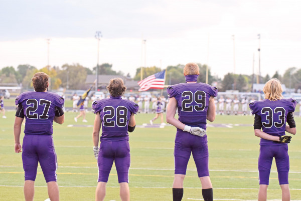 James Ochs, Beau Dantic, Colter Bales and Chase Burrows stand for the National Anthem before the Billings Central matchup on Sept. 25.