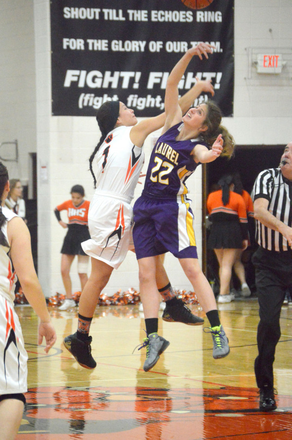 Photo courtesy of Jennifer Boehler.  Paige O'Toole goes for the jump ball in Laurel's game against Hardin last week. O'Toole had 12 points in the game.