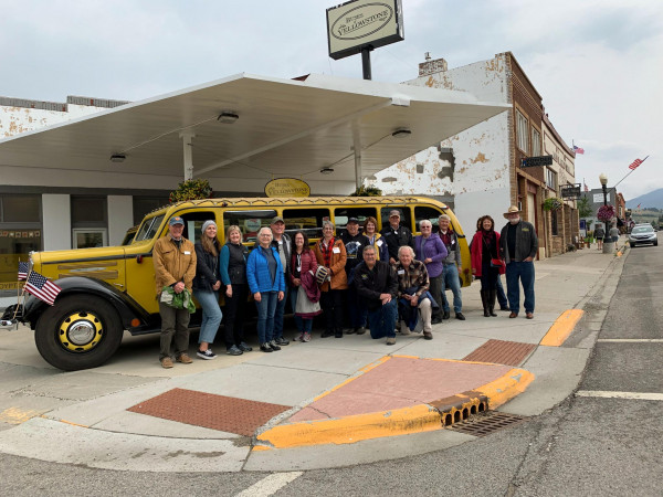 Members of the Montana Historical Society board celebrate the Red Lodge bus project. The building has now been refurbished and stuccoed.