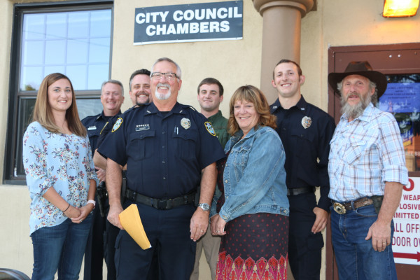 In addition to Chief Rick Musson, front and center, new Laurel Police Department Officer Chase Rasmussen, second from the right, had his parents, Roy and Gina Rasmussen and his girlfriend, Annie, on hand to witness his swearing in ceremony Tuesday at the city council meeting. Also participating were Captain Mark Guy, Officer Stan Langve, and Montana Highway Patrol Trooper Chase.