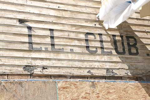 Old L.L. Club. Outlook photo by Kathleen Gilluly. During the remodeling of the façade on the Eagles building at 315 W. Main St., crews uncovered what may have been the original wooden siding with a sign for the L.L. Club.