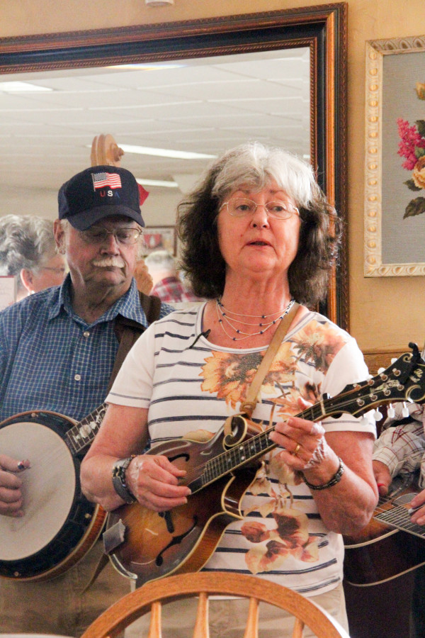 "LaLonnie Larson of the band Highway 302 sings a Carter Family classic, ""When the Springtime Comes Again,"" at the Owl Cafe on Saturday morning while Jim McGowen, of Joliet, plays banjo in the background."